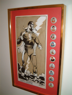 A Don Newton original of Captain Marvel framed with a set of the Fawcett pin set